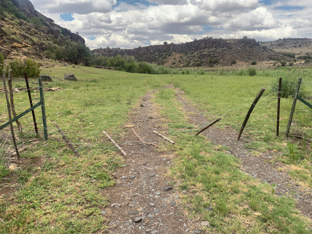 Gate to a fence separating the Wenima Wildlife Area from the adjacent state land leased for grazing, per lease #05-001662 on July 23, 2019. The wires had been cut.