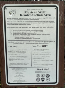 Vandalized Mexican Wolf Reintroduction Area sign, Honeymoon Campground, Clifton Ranger District, August 2020.