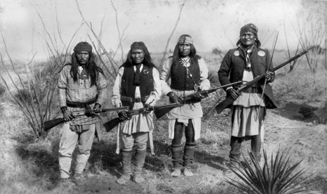 Chiricahua Apache leader Geronimo (R) and three warriors, 1886